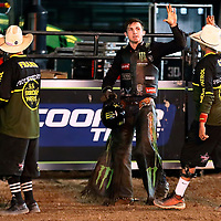 CHEYENNE, WY - JULY 26: Cody Teel celebrates his ride of bull American Gangster with bullfighter Cody Webster during the Professional Bull Riders Last Cowboy Standing on July 26, 2021, at the Cheyenne Frontier Days, Cheyenne, WY. (Photo by Chris Elise)