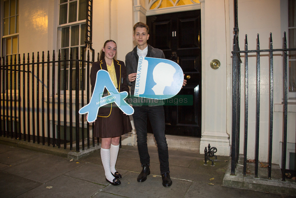 Tara Whelan (a winner of the Diana Award and singer James McVey posing for photos outside 11 Downing Street to celebrate seventeen years of the Diana Award. This award, set up in memory of Princess Diana, today has the support of both her sons the Duke of Cambridge and Prince Harry. Photo date: Wednesday, October 19, 2016. Photo credit should read: Richard Gray/EMPICS Entertainment