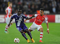 Arsenal's Alexis Sanchez chases down Anderlecht's Frank Acheampong - Photo mandatory by-line: Dougie Allward/JMP - Mobile: 07966 386802 - 22/10/2014 - SPORT - Football - Anderlecht - Constant Vanden Stockstadion - R.S.C. Anderlecht v Arsenal - UEFA Champions League - Group D