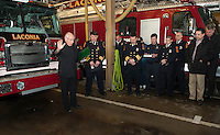 Father Mark Drouin offers the blessing for Laconia Fire Dept's new Engine 1 at Central Station on Tuesday afternoon.  (Karen Bobotas/for the Laconia Daily Sun)