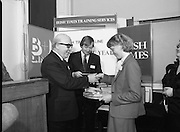 Typist Of The Year.1983.17.11.1983.11.17.1983.17th november 1983..Ms Paula Sommers won the award of Typist Of The Year which was jointly sponsored by The Irish Times and B & I Lines..Image of Mr Peter Coffey,Personnal and Training Manager ,B&I lines,congratulates Paula on her success. Mr Des Bury from the Irish Times looks on.