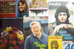Old East German propaganda posters at offices of East German secret Police now STASI Museum in Berlin Germany