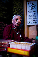 An old man sits in his tradtional tea shop on the outskirts of Hanoi, Vietnam