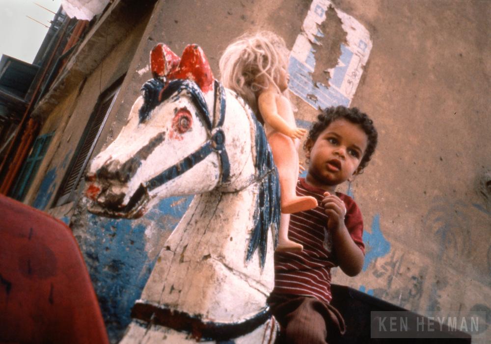 Cairo, Egypt, a boy on a homemade merry-go-round.