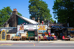 Aladin's Cave, a well known Lewisham landmark that deals in reclaimed Building materials, antiques and furniture, in what was once the Lewisham Road railway station which closed in 1917. The site has apparently been sold to a property developer. London, July 02 2018.