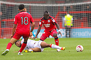Crawley Town Midfielder Aliu Djalo battles for the ball during the EFL Sky Bet League 2 match between Crawley Town and Luton Town at the Checkatrade.com Stadium, Crawley, England on 17 September 2016. Photo by Phil Duncan.