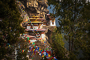 Taktsang or Tiger's Nest Monastery sitting precariously on the side of a cliff in Bhutan