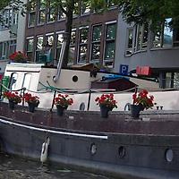 Europe, Netherlands, Amsterdam. Canal Houseboat, Amsterdam.