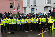 Police hold back black block who joined locals from Dover, Folkestone and Thanet today called a demonstration to welcome refugees into the UK via Dover. Organised by Kent anti racism network. Dover, Kent.