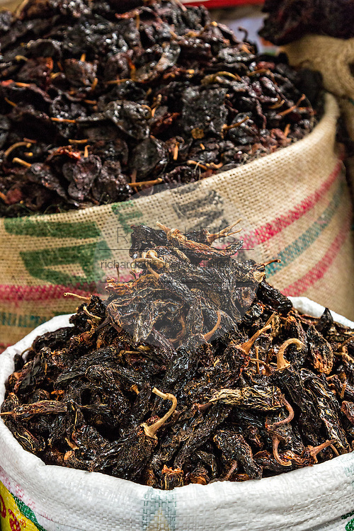 Dried and smoked pasilla peppers at Benito Juarez market in Oaxaca, Mexico.