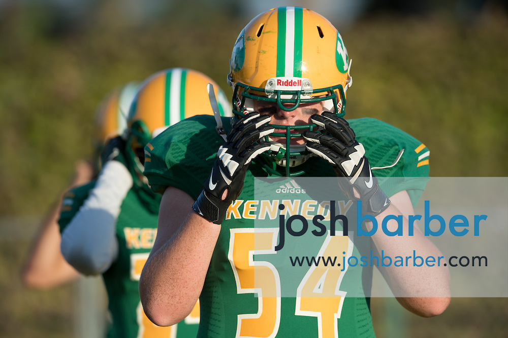 Kennedy's Jacob Beckler adjusts his helmet before a non-league game against Northwood A nonleague football game between Northwood High School of Irvine and John F. Kennedy High School at Glover Stadium on Thursday, September 1, 2016 in Anaheim, California. (Photo/Josh Barber)