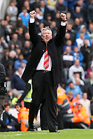 Football - Premier League - Blackburn Rovers vs. Manchester Utd<br /> Alex Ferguson, manager of Manchester United triumphantly punches the air following the referees final whistle at Ewood Park