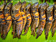 08 JUNE 2017 - BANGKOK, THAILAND: Grilled catfish in Khlong Toey Market, Bangkok's main fresh market. Thai consumer confidence dropped for the first time in six months in May following a pair of bombings in Bangkok, low commodity prices paid to farmers and a sharp rise in the value of the Thai Baht versus the US Dollar and the EU Euro. The Baht is surging because of political uncertainty, related to Donald Trump, in the US and Europe. The Baht's rise is being blamed for a drop in Thai exports. This week the Baht has been trading at around 33.90 Baht to $1US, it's highest point in two years.      PHOTO BY JACK KURTZ