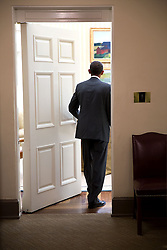 President Barack Obama returns to the Oval Office after a meeting in the Roosevelt Room of the White House, Sept. 29, 2014. (Official White House Photo by Pete Souza)<br /> <br /> This official White House photograph is being made available only for publication by news organizations and/or for personal use printing by the subject(s) of the photograph. The photograph may not be manipulated in any way and may not be used in commercial or political materials, advertisements, emails, products, promotions that in any way suggests approval or endorsement of the President, the First Family, or the White House.