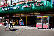 Amusement arcades along the front at Southend-on-sea, Essex. The town could be described as run down as while there are some signs of affluence, these are few and far between. The predominant atmosphere is quite rough feeling and quite poor. Southend is a seaside resort that is very popular with people from the East side of London due to it's close proximity, just an hour away by train along the Thames Gateway. With the decline of seaside resorts, from the 1960s much of the centre was developed for commerce and many of the original features were destroyed through redevelopment or neglect.
