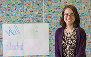 Mariela Niland poses for a photograph in her classroom at Young Women's College Preparatory Academy, August 27, 2013.