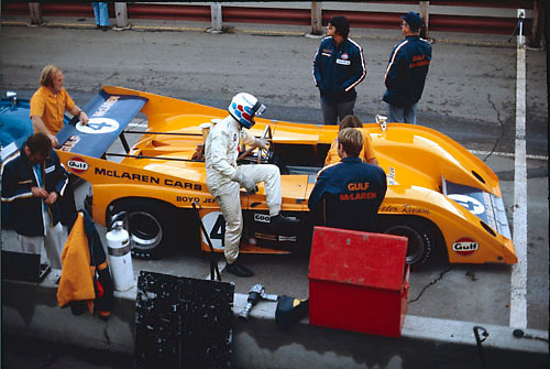 Peter Revson climbs aboard his McLaren M20 during practice for the 1972 Can-Am at Edmonton, Canada; Photo by Ozzie Lyons 1972/ © 2014 Pete Lyons / petelyons.com