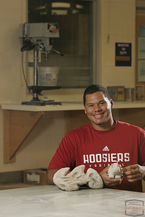 Hoosier Football player Andrew McDonald poses for portraits in his sculpture classroom at Indiana University Friday, Sept. 26, 2008, in Bloomington, Ind.