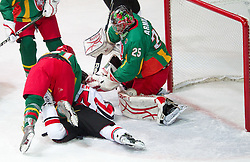 Fabio Hofer of Austria smashed  between Marius Krikstanaitis of Lithuania and goalkeeper Mantas Armalis of Lithuania  during the ice hockey match between National teams of Lithuania (LTU) and Austria (AUT) at 2011 IIHF World U20 Championship Division I - Group B, on December 12, 2010 in Ice skating Arena, Bled, Slovenia.  (Photo By Vid Ponikvar / Sportida.com)