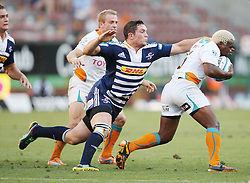 Francois Louw chases down Kabamba Floors during the Super Rugby (Super 15) fixture between the DHL Stormers and the Cheetahs held at DHL Newlands Stadium in Cape Town, South Africa on 26 February 2011. Photo by Jacques Rossouw/SPORTZPICS