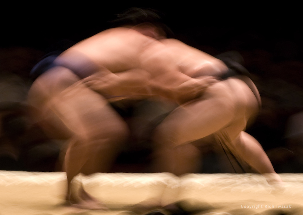 Blurred motion view of Kotomitsuki (left) and Asashoryu competing in the semi-final round of Day 1 of Grand Sumo Tournament Los Angeles 2008, Los Angeles Sports Arena, Los Angeles, California