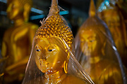 Covered buddhas for sale in shopts situated in the heart of Bangkok, near the famous swing, is a series of streets and alleyways dedicated to the manufacture of Buddhist and Hindu icons together with other religious paraphernalia.