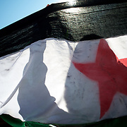 January 20, 2012 - Idleb, Syria: A group of protestors hold a Syrian revolutionary flag during a anti-regime demonstration in central Taftanaz.