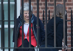 © Licensed to London News Pictures. 29/10/2018. London, UK. Prime Minister Theresa May shares a joke with a staff member (R) as she arrives at the back of Downing Street. Later today the Chancellor will deliver his Autumn Budget to Parliament. Photo credit: Peter Macdiarmid/LNP