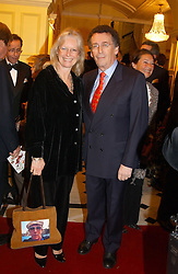 Actor ROBERT POWELL and his wife BABS at a party to say goodbye to George Goring and hello to his son Jeremy Goring as MD of the Goring Hotel,Beeston Place, London on 2nd March 2005.<br /><br />NON EXCLUSIVE - WORLD RIGHTS