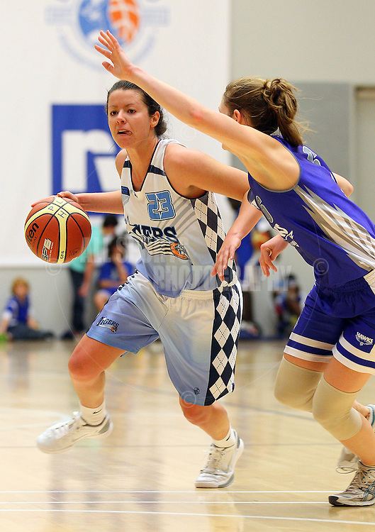 PERTH, AUSTRALIA - JULY 16: Kate Malpass of the Tigers brings the ball down the court during the week 18 SBL game between the Perry Lakes Hawks and the Willetton TIgers at The State Basketball Center on July 16, 2011 in Perth, Australia.  (Photo by Paul Kane/All Sports Photography)