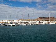 Yachts at moorings Caleta de Sebo harbour and village, La Isla Graciosa, Lanzarote, Canary Islands, Spain