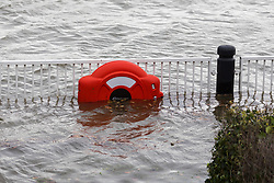 © Licensed to London News Pictures. 10/02/2020. London, UK. A lifering on railings is seen underwater during flooding at the Thames Barrier in London which is seen closed this afternoon at high tide to protect the capital from flooding during Storm Ciara. The Thames Barrier prevents the floodplain of most of Greater London from being flooded by exceptionally high tides and storm surges.  Photo credit: Vickie Flores/LNP