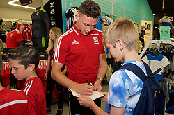 CARDIFF, WALES - Thursday, June 2, 2016: Wales' James Chester signs autographs during a visit to a JD Sports store in Llantrisant. (Pic by Ian Cook/Propaganda)