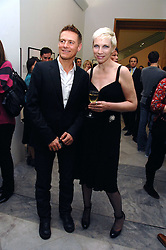 BRYAN ADAMS and singer ANNIE LENNOX at a private view of Bryan Adam's photographs entitled 'Modern Muses' held at The National Portrait Gallery, London on 11th March 2008.<br />