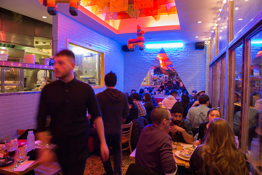 New York, NY - 11 February 2014. The dining room of Mission Cantina is festooned with papels picados, Mexican paper cuttings.