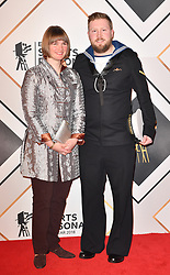 Millie Knight (left) and guide Brett Wild during the red carpet arrivals for the BBC Sports Personality of the Year 2018 at The Vox at Resorts World Birmingham.