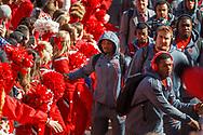 Ameer Abdullah walks past fans and cheerleaders as he enters the stadium with his teammates prior to Nebraska's game against Purdue at Memorial Stadium on Nov. 1, 2014. © Aaron Babcock