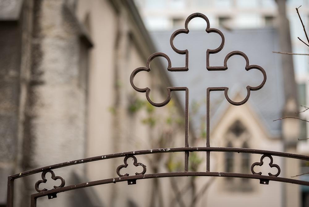 24 November 2019, Geneva, Switzerland: Cross on the fence of the Emmanuel Epicopal Church, Geneva.