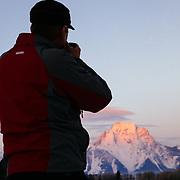 Doug Wachob shoots photos of sunrise over Mount Moran in Grand Teton National Park.