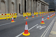 As the UKs Conornavirus pandemic lockdown continues, but with travel restrictions and social distancing rules starting to ease after three months of closures and isolation, yellow barriers and social distance cones have narrowed the road in favour of wider pedestrian pavements outside the Bank of England on a deserted Threadneedle Street, on 9th June 2020, in London, England.