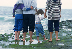 Detail of  the back of a family exploring Laguna Beach, CA