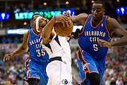 Vince Carter (25) of the Dallas Mavericks is fouled by Kendrick Perkins (5) of the Oklahoma City Thunder at the American Airlines Center in Dallas on Sunday, March 17, 2013. (Cooper Neill/The Dallas Morning News)
