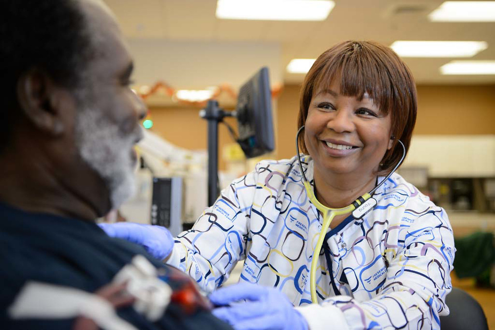 Healthcare worker taking the vital signs of a dialysis patient. Image shot for the annual report of a nationwide healthcare chain.