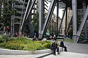 At the exterior of the Leadenhall Building, office and city workers enjoy a lunch break in the newly refurbished square, surrounded by new high rise modern architecture in the City of London, England, United Kingdom. As Londons financial district grows in height, the classical buildings are being dwarfed by the towers of glass.
