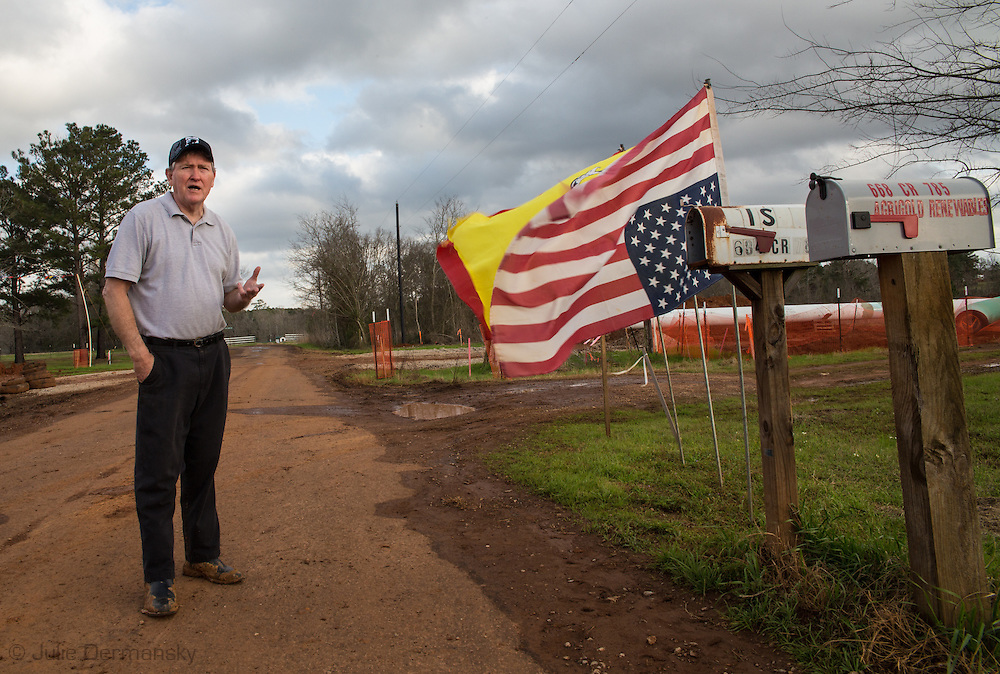 Douglas, Texas, February 19, Mike Bishop's American flag flying upside down in front of his property. He flies his flag upside down to show his property is under distress as TransCanada installs the Keystone XL pipeline against his will.The Southern portion of the Keystone XL pipeline was approved and fast-tracked by President Obama in 2012 thought the northern segment was put on hold for further environmental studies.
