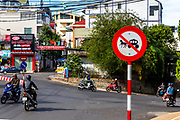 No horse or carriage street red sign in Dalat Vietnam. Motorcycles, street intersection and buildings in the background. RAW to Jpg