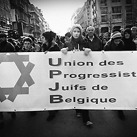 Brussels, Belgium -  11 January 2009.Pro Palestina demonstration. .Demonstrators protest Sunday against Israel's attacks on the Gaza Strip as the bombing campaign entered its third week, while pro-Israel demonstrators also took to the streets in Antwerp..One of the biggest pro Palestina rallies took place in Brussels where a march attended by 30,000 people, according to the police, ended in incidents of violence during which a regional politician was slightly injured and windows smashed..PHOTO: EZEQUIEL SCAGNETTI