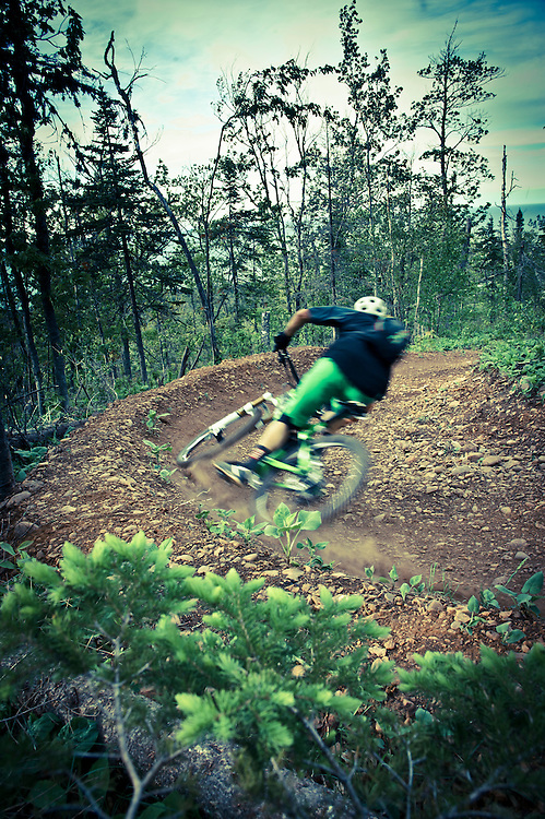 Professional mountain biker Andrew Shandro rides The Flow trail in Copper Harbor Michigan.