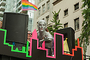 A silver-painted performer in the 2011 Pride Parade on New York's Fifth Avenue.