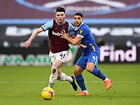 Football - 2020 / 2021 Premier League - West Ham United vs Brighton & Hove Albion - London Stadium<br /> <br /> West Ham United's Declan Rice holds off the challenge from Brighton & Hove Albion's Neal Maupay.<br /> <br /> COLORSPORT/ASHLEY WESTERN